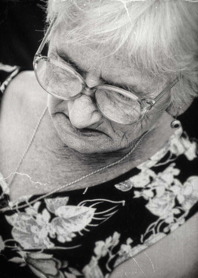 Lonely senior woman stock photography