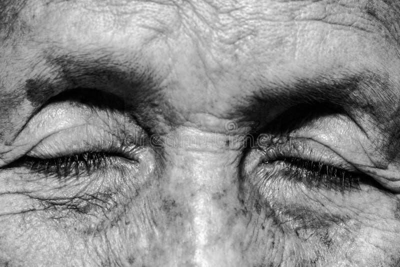 Lonely senior woman stock photos