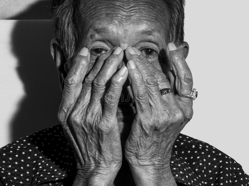 Lonely senior woman portrait sad depressed,emotion, feelings, thoughtful, senior, old woman,wait, gloomy, worried, covering her f royalty free stock photo