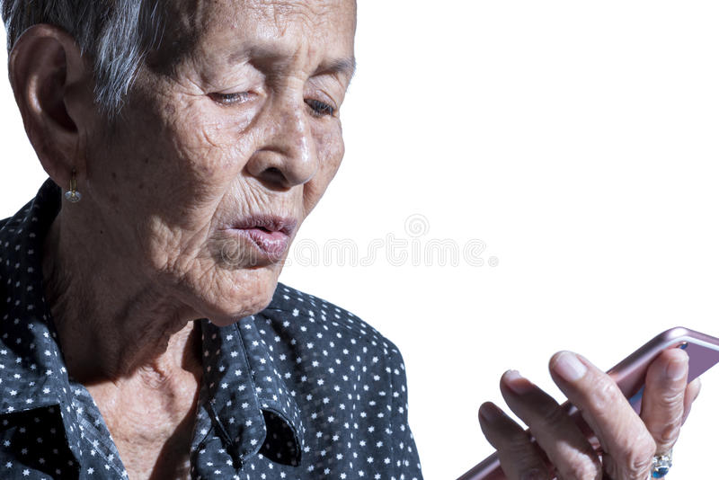 Lonely senior woman portrait sad depressed,emotion, feelings, thoughtful, senior, old woman,wait, gloomy, worried, covering her f stock photo