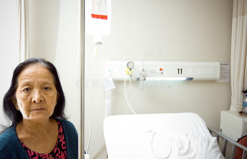Lonely sick old woman at hospital stock photography