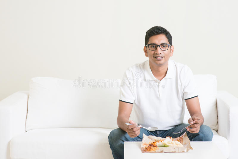 Lonely single man eating food at home royalty free stock photography