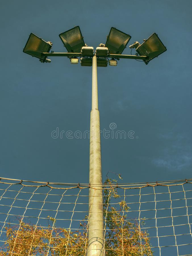 Lonely stadium light or lamp post with Union of light bulb stand alone with clould and blue sky royalty free stock photos