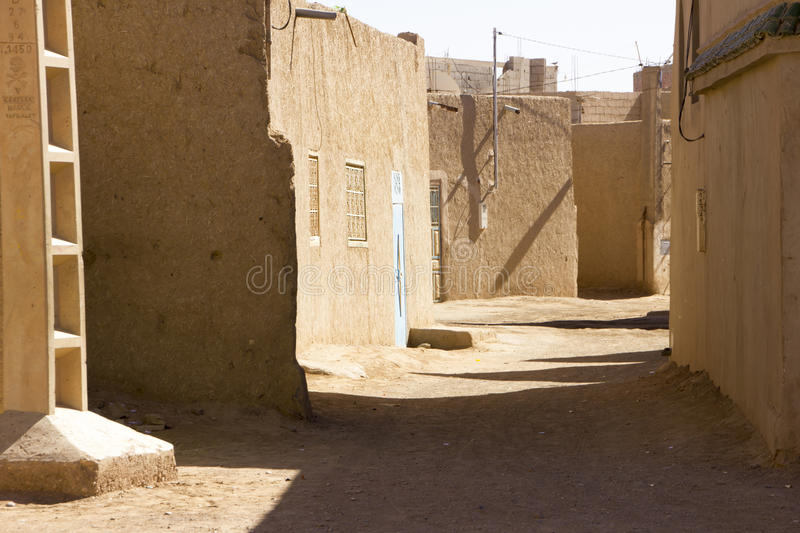 Lonely Street In Merzouga Village. One lonely street in the village of Merzouga in southeastern Morocco right on the edge of the Saharan Erg Chebbi desert stock image