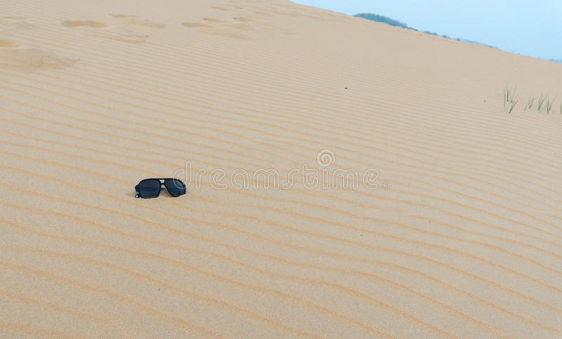 Lonely sunglasses in the desert stock photography