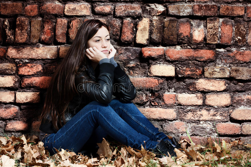 Lonely teenage girl stock images