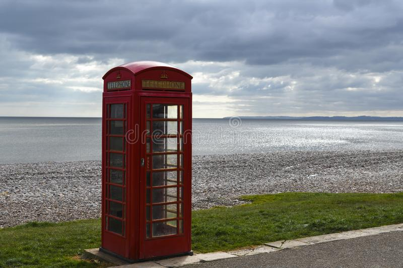 Lonely Telephone Box. A lonely Telephone booth on the promenade of Budleigh Salterton on the south west coast of Britain. 20 March 2018 royalty free stock photos