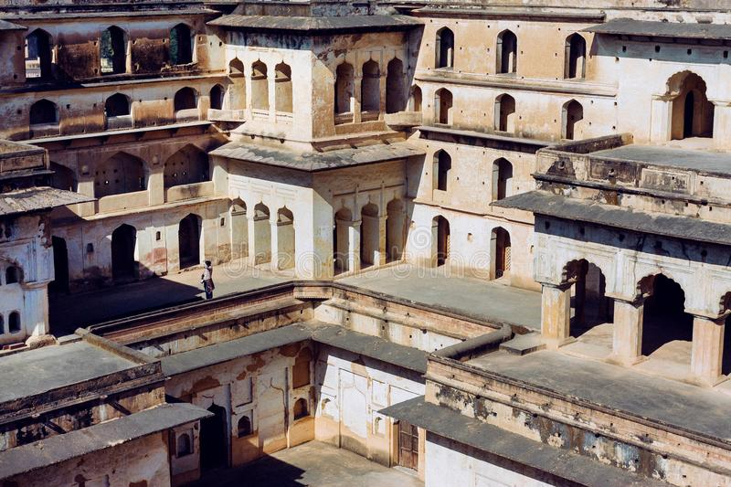 Lonely tourist inside the 17th century Citadel of Jahangir with towers and arches, Orchha in India. Example of mix of Indian and Mughal style of architecture stock photos
