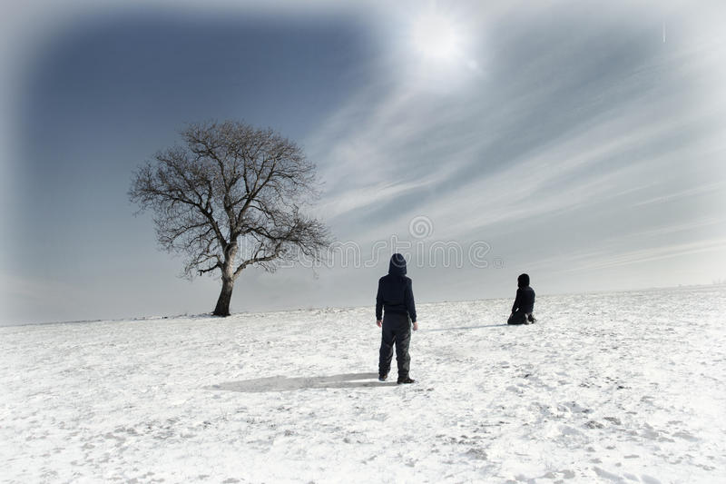 Lonely tree in winter and two people. Lonely tree in winter fields and two people stock photos