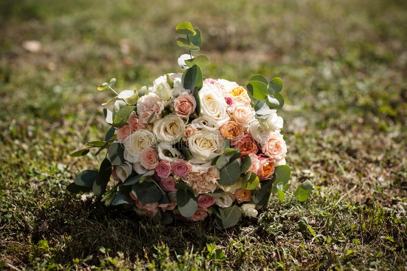 Wedding bouquet on the grass stock photo
