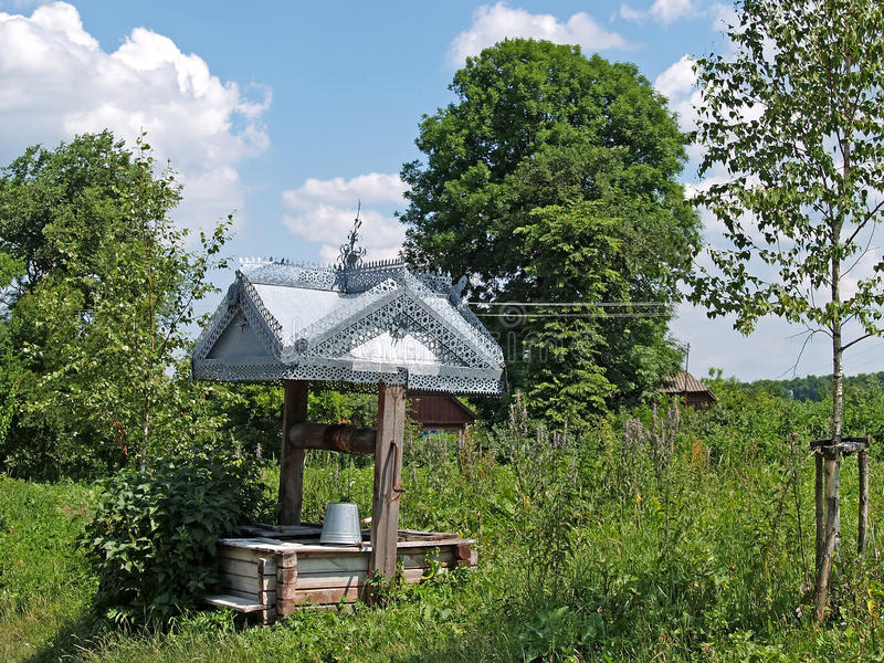 Lonely well in the village.  royalty free stock images