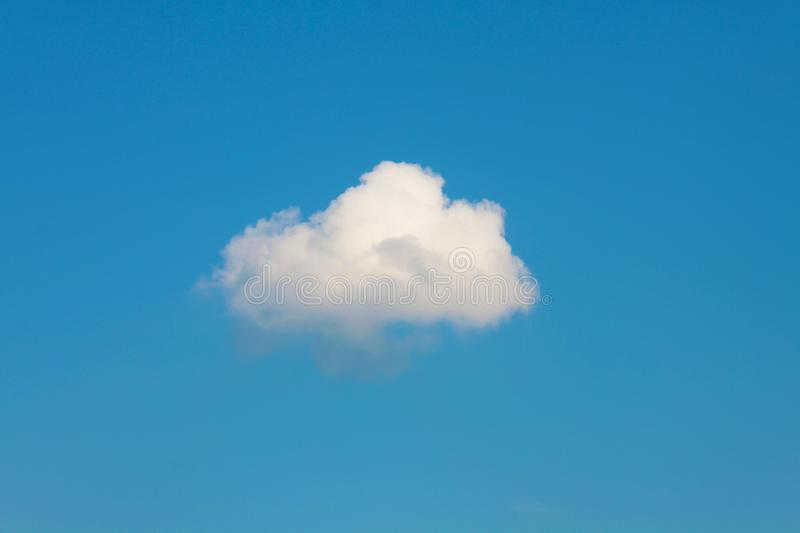 Lonely white cloud on a blue sky.  royalty free stock photos