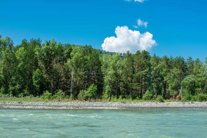 Lonely white cloud in the blue sky. Above the river royalty free stock photos