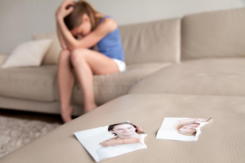 Lonely wife suffering after breakup at home stock images