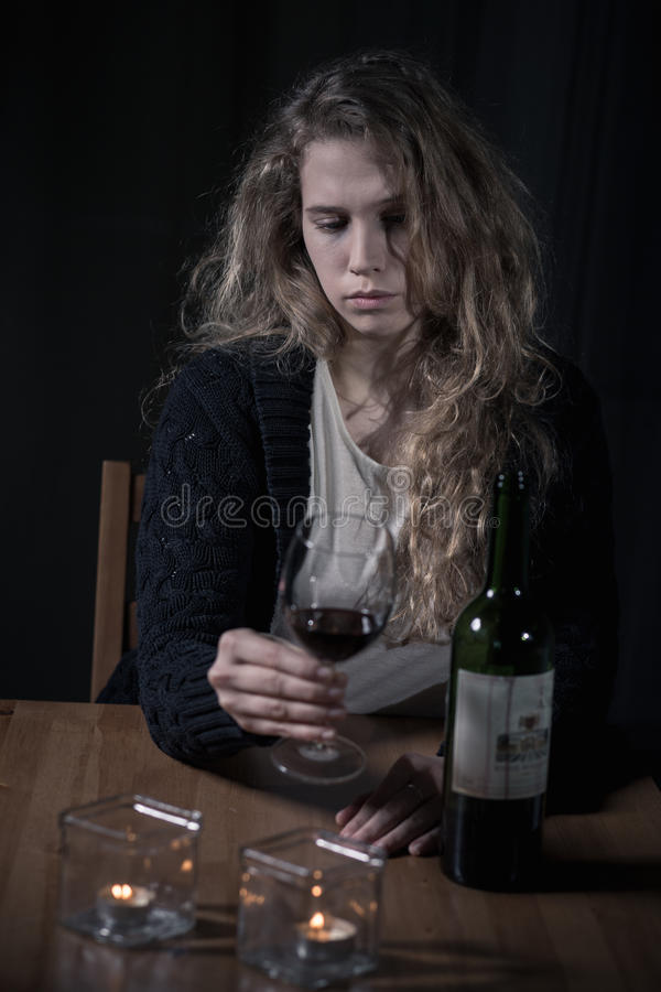 Lonely woman addicted to alcohol. Drinking wine stock images