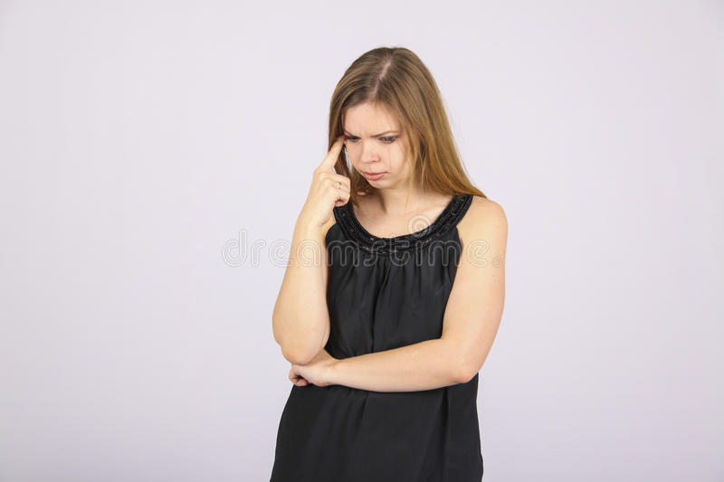 Lonely woman in depression. Woman with serious face with a soft but solemn stare stock photo