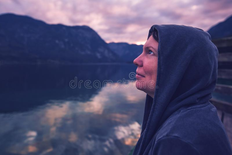 Lonely woman looking at dramatic sky royalty free stock images