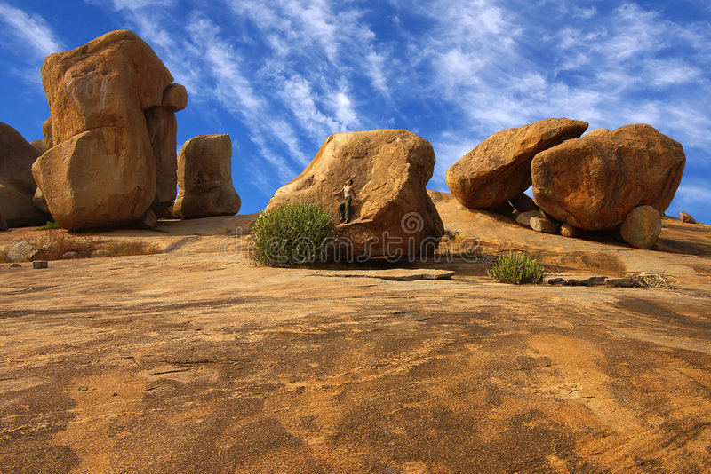 Download Lonely The Woman On A Rock In Hampi. Stock Images - Image: 8229124