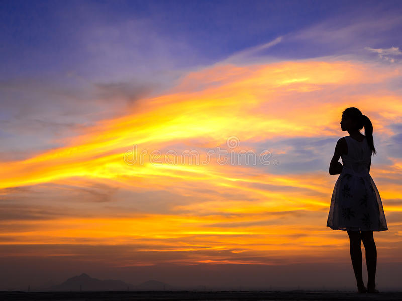 Lonely woman on the roof. Silhouette of free woman enjoying freedom feeling happy at sunset. relaxing woman in pure happiness stock image
