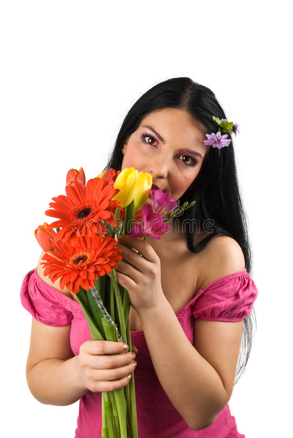 Lonely woman with spring flowers stock photos