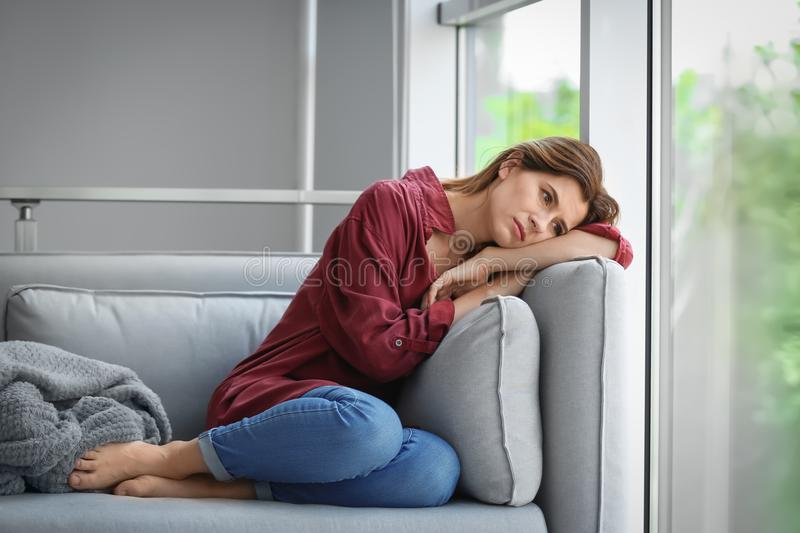 Lonely woman suffering from depression stock photo