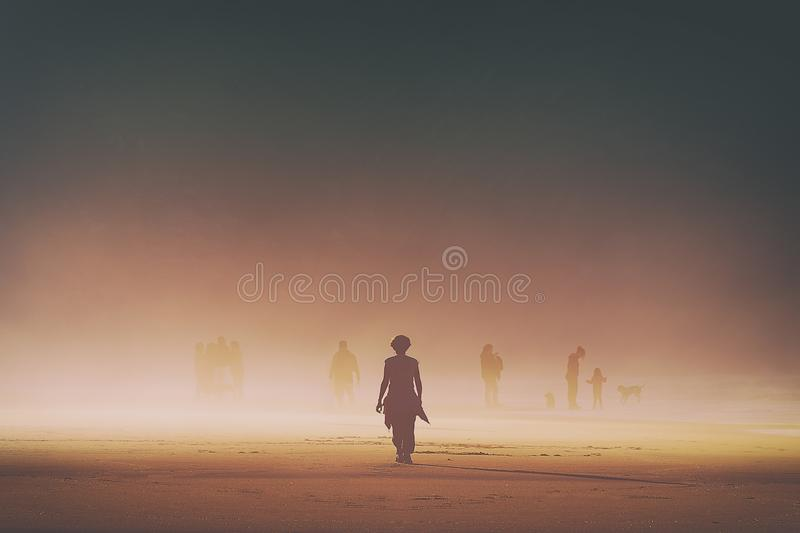 Lonely woman walking on beach royalty free stock image