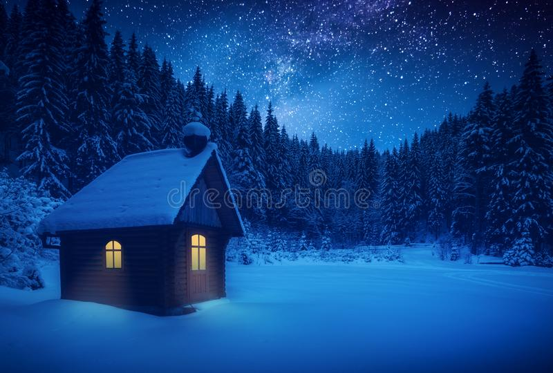 Lonely wooden house on a meadow in a deep forest stock photo
