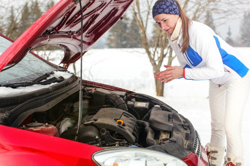 Lonely worried young woman in sport jacket looking on engine stock photos