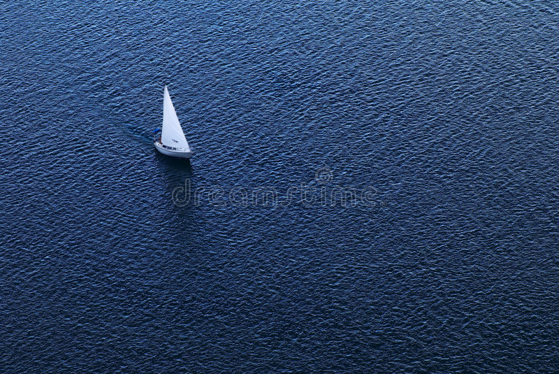 Lonely yacht stock photography