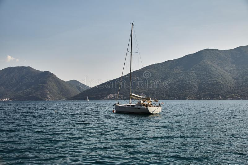 A lonely yacht in the Bay of Kotor. Montenegro. Summer royalty free stock image