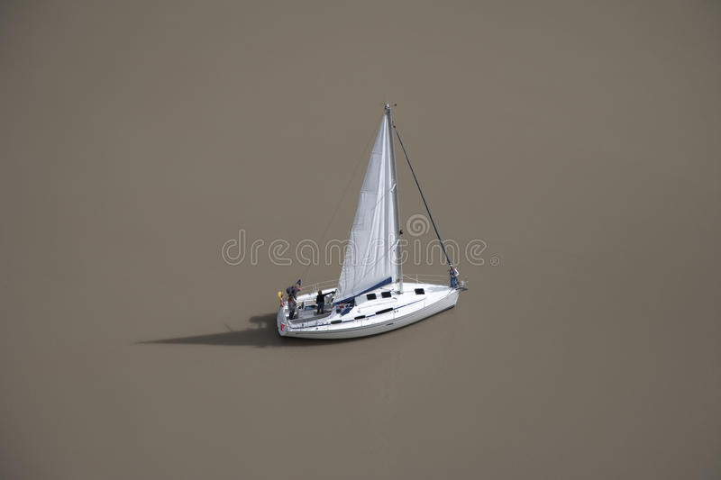 Lonely yacht on river (aerial view) royalty free stock photography
