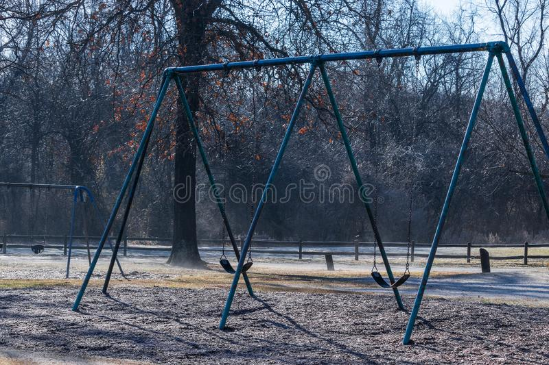 Lonesome swingset in the winter royalty free stock images