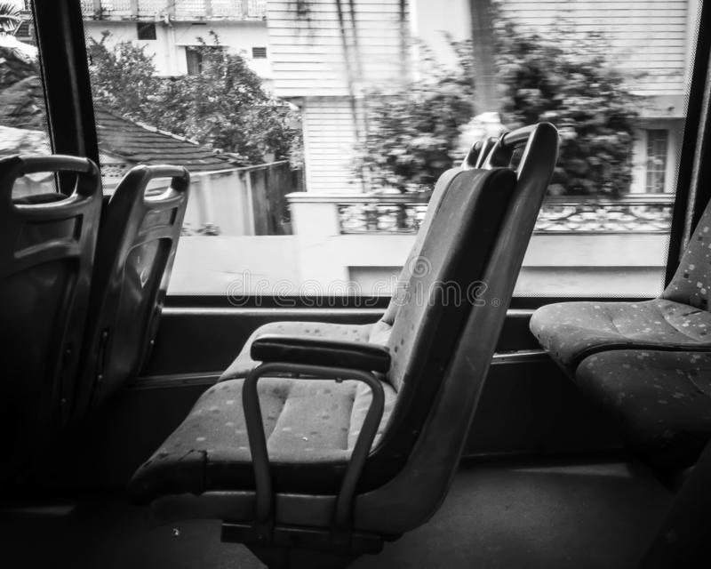 Loney bus commute. A lonely commute to work by bus in clean classic black and white monochromatic style royalty free stock photos