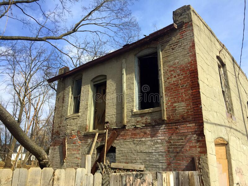 Two story abandoned business upper back view stock photography