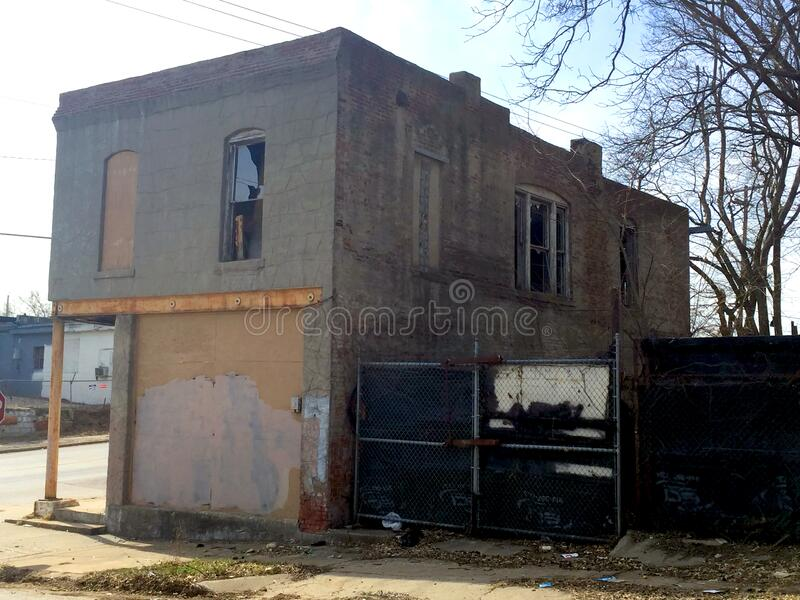 Two story abandoned business front view with fencing royalty free stock images