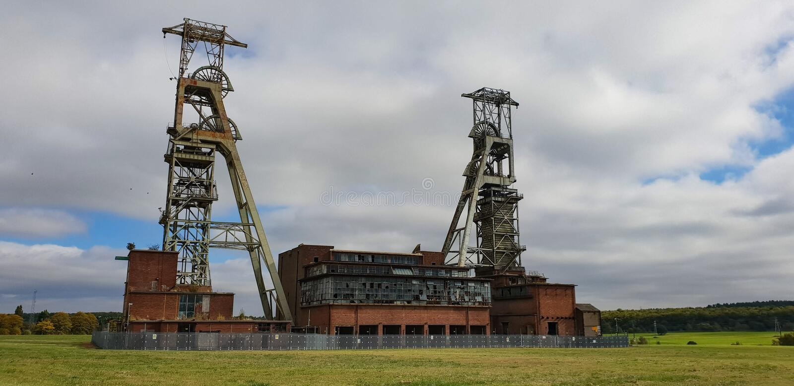 Kings Clipstone abandoned mine shaft pit head. The long abandoned pit head derricks at the Kings Clipstone colliery coal mine in Mansfield Woodhouse Nottingham royalty free stock images