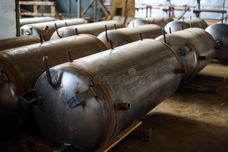 Long armored tank for storage and the storage of natural gas on the plant stock photos