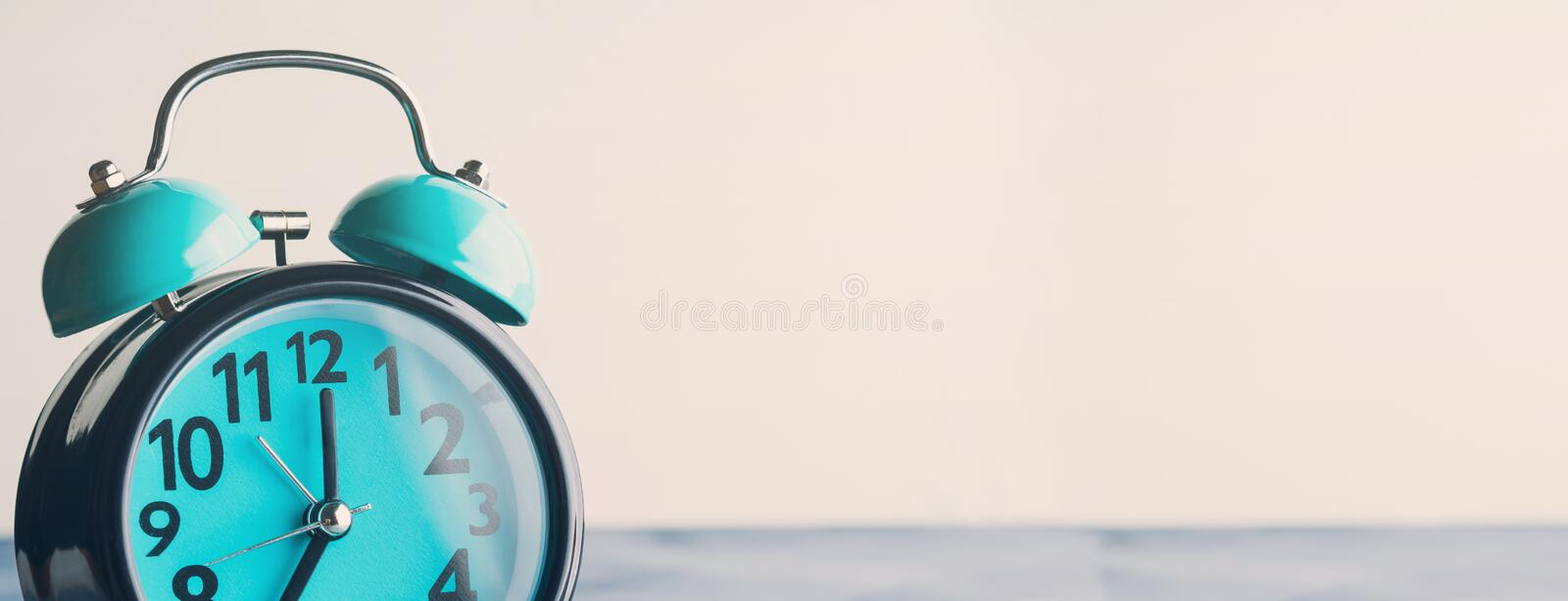 Long banner with alarm clock. Long banner with blue alarm clock. Waking up, time concept royalty free stock image