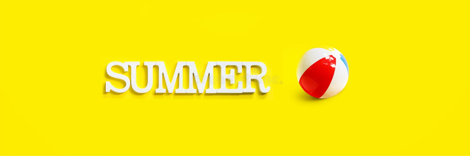 Long banner inflatable ball color white blue red. White volume letters top view. summer time. flat lay yellow background copy space single concept Copy space royalty free stock images