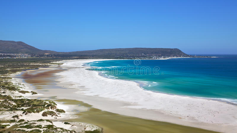 Long Beach. The expanse of Long Beach, with Kommetjie in the background, Cape Peninsula, South Africa royalty free stock photos