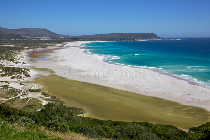 Long Beach. The expanse of Long Beach, with Kommetjie in the background, Cape Peninsula, South Africa royalty free stock image