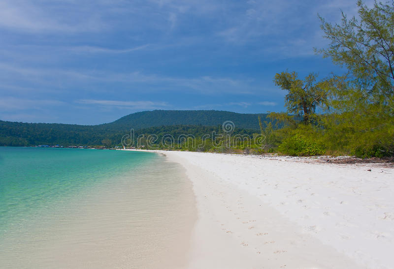 Long beach ob koh Rong island in Cambodia. With white sand and green sea royalty free stock photo