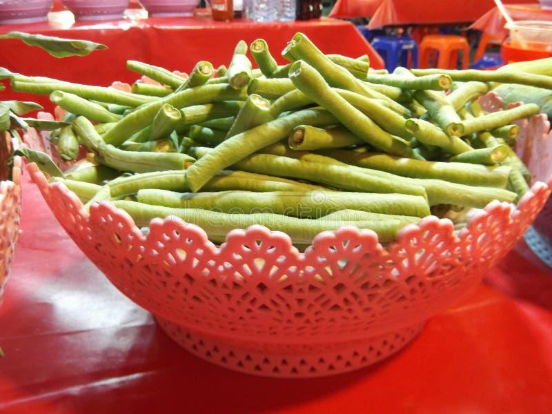 Long bean for mix with Thai vermicelli,Street food , Buddha festival, Samutprakarn ,Thailand. Long bean for mix with Thai vermicelli eaten with currry,Street stock image