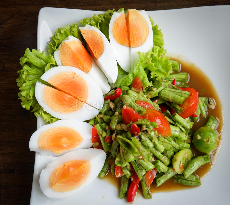 Long bean salad Spicy and egg thai food stock photo