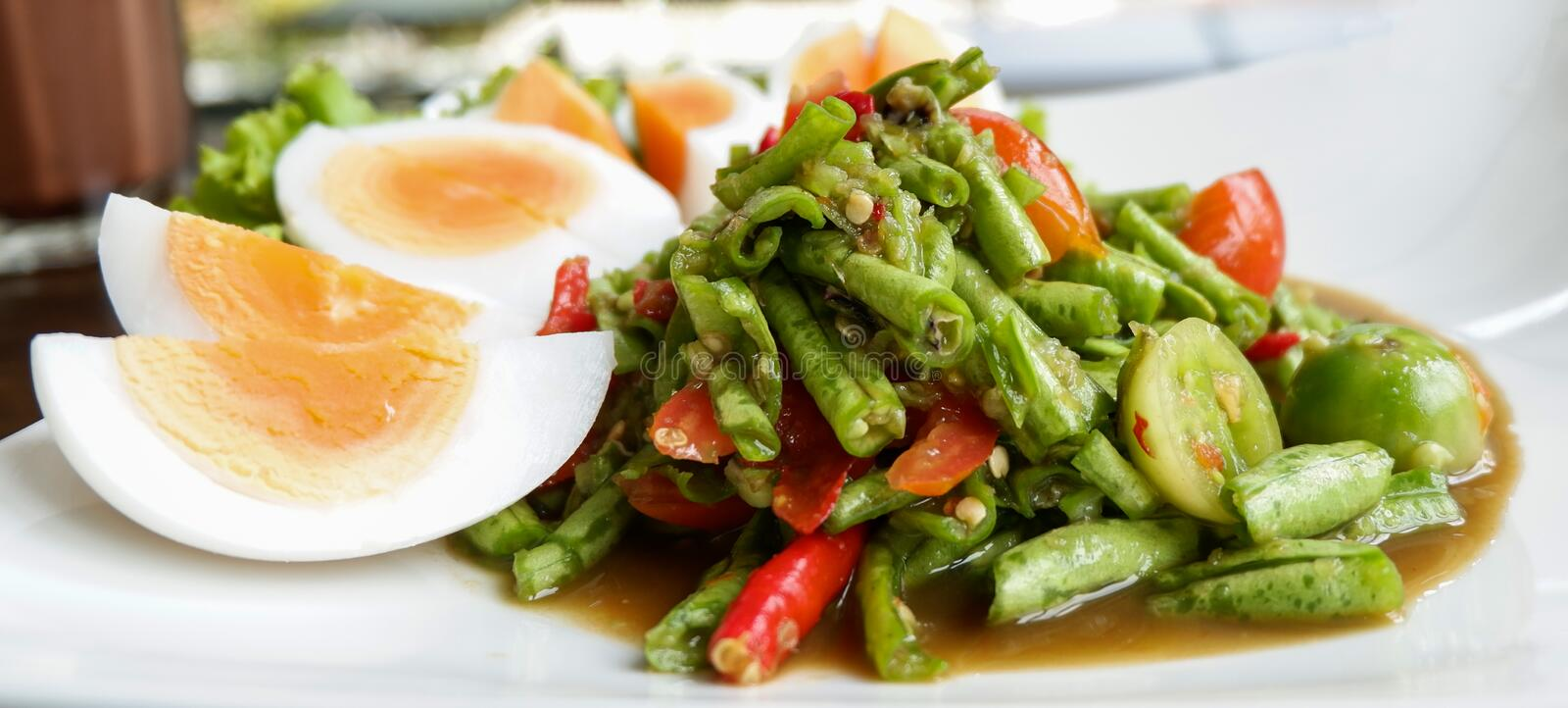 Long bean salad Spicy and egg thai food stock images