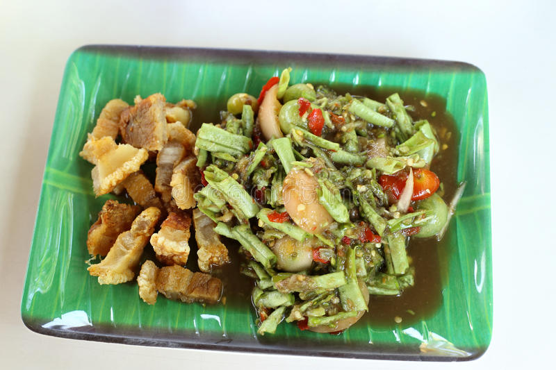 Long Bean Spicy Salad with Crispy fried streaky pork recipe royalty free stock image