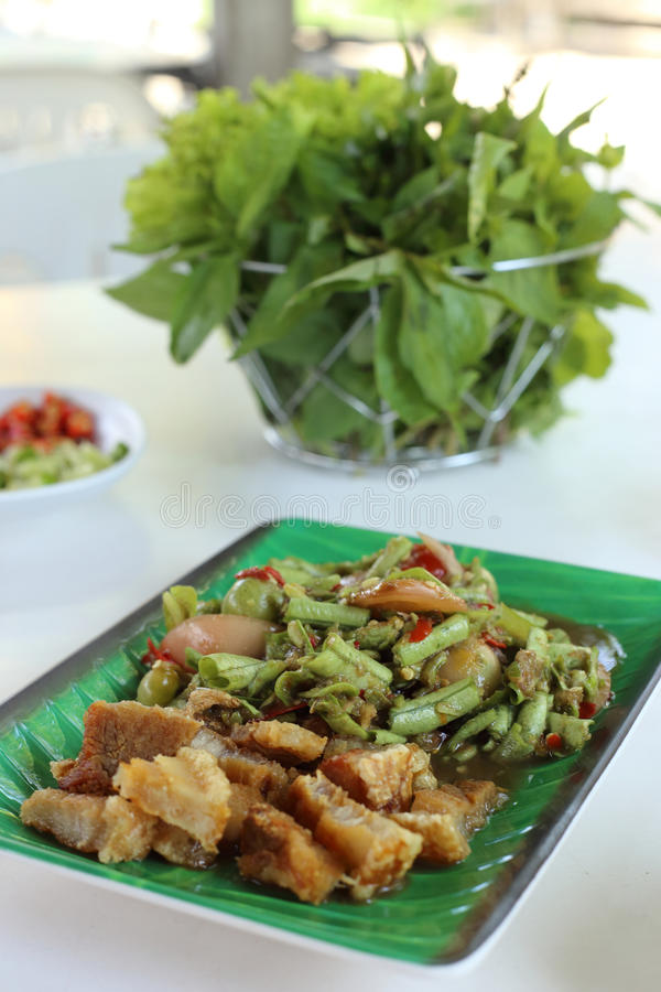 Long Bean Spicy Salad with Crispy fried streaky pork recipe stock image