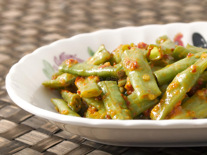 Long beans in chili shrimp paste. Close up of a plate of stir fried long beans in chili shrimp paste royalty free stock photos