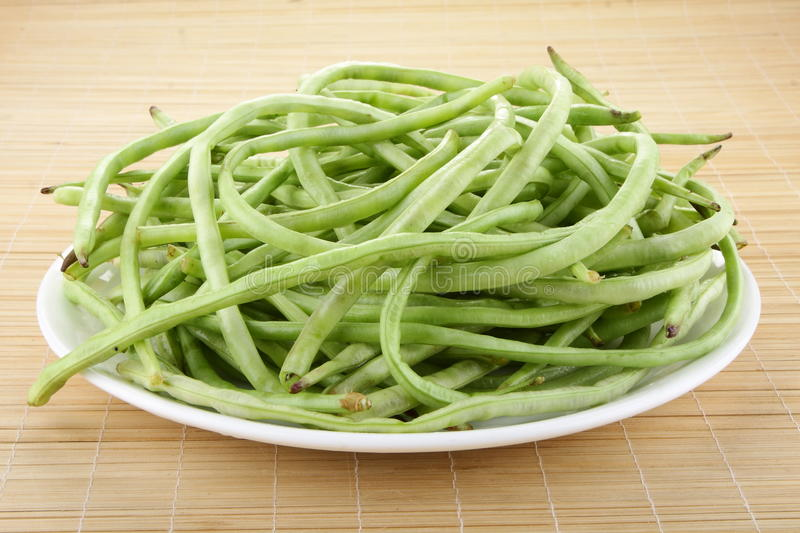 Long beans. Fresh long beans in plate royalty free stock images