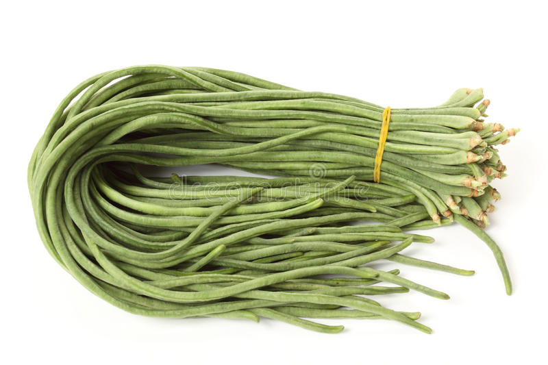 Long beans. Fresh long beans on a white royalty free stock photos